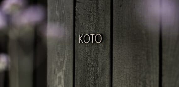 Close up shot of charred timber cladding used on a cabin with name KOTO on it